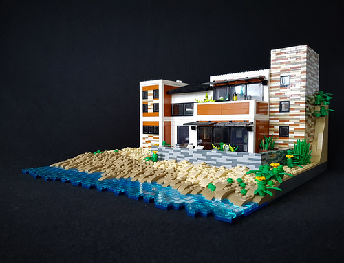Orange Beach House MOC. Black background.