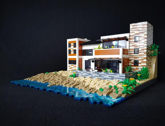 Orange Beach House MOC. Black background.