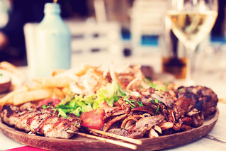 Assorted delicious mix grill dish in restaurant, Bali island. | by Artem Beliaikin
