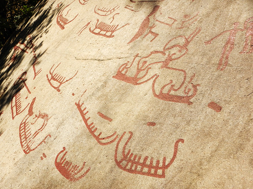 Petroglyphs of boats full of bronze age people chipped out of the granite at Tanum, a UNESCO World Heritage Rock Art Centre in Sweden