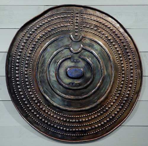 Round bronze metal shield fabricated by the Bronze Age people that lived at Tanum, a UNESCO World Heritage Rock Art Centre in Sweden