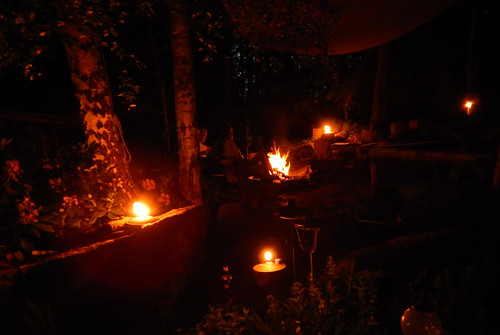 Lit candles lead the way to a firepit on a warm summer's night in Sweden