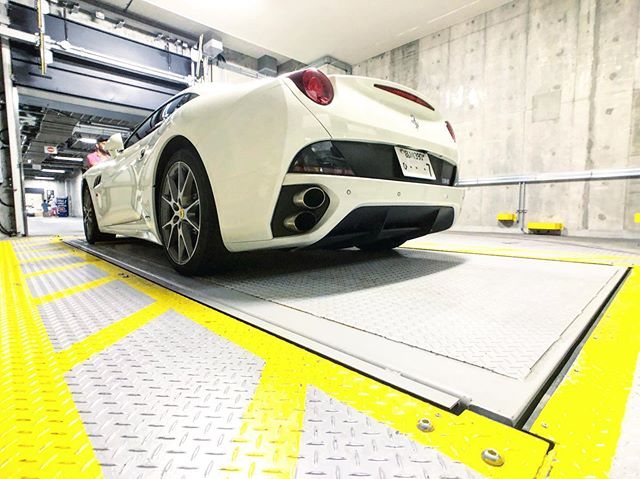 They say there is a vending machine for everything in Japan. This automated parking garage seemed like a supercar vending machine! In reality the owner has to type in some code, you hear all sorts of machinery moving, then a car pops up on this platform s