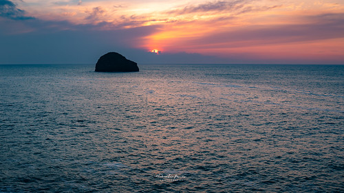 sunset sunrise island seascape sea travel explore sky orange cornwall trebarwithstrand trebarwith uk england ocean atlantic