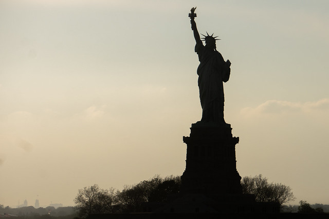 statue of liberty sillhouette at sunset