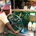Inidan man, operating sugar cane juicer, Kolkata (Calcutta) India