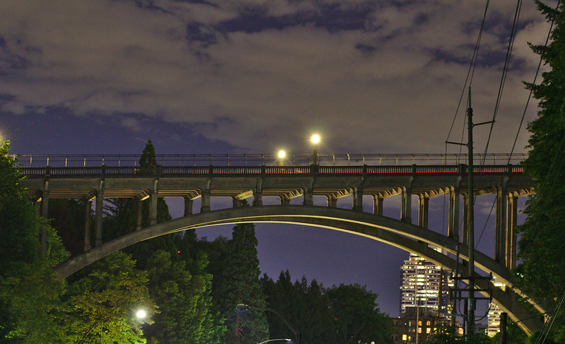 Evening view of Vista Bridge with a red car tail light crossing the bridge