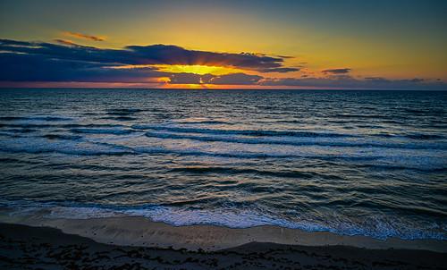 satellitebeach florida unitedstatesofamerica sunrise over atlantic ocean satellite beach fl fla america water morning dawn yellow orange