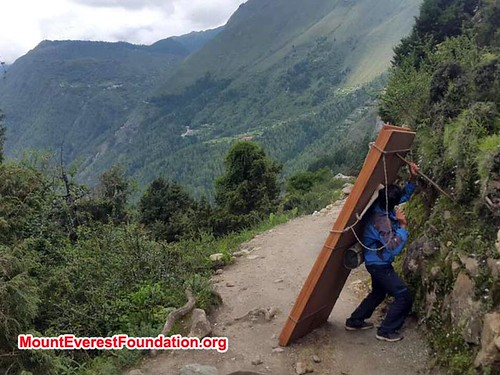 Porter carrying wood for Deboche. From Daniel Mazur and the redemption of Mt. Everest
