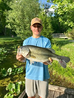 Photo of  young man holding up a largemouth bass