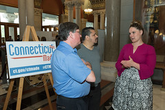 State Rep. Stephanie Cummings talks with Waterbury residents Ray Work and Job Rosario during Connecticut Made Day at the Capitol.