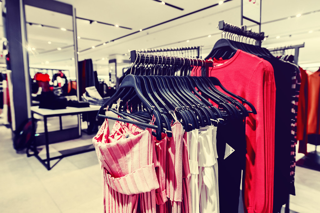 Women clothes in fashion store. Shopping mall. Women fashion shopping concept.