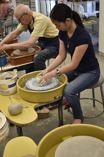 Olivia at the wheel in pottery