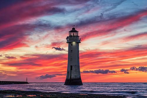 formatthitechfirecrest fortperchrock sea yellow orange red clouds sunset wirral rivermersey landscape seascape lighthouse newbrighton wallasey merseyside england unitedkingdom