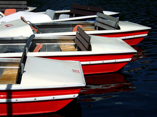 Three red boats