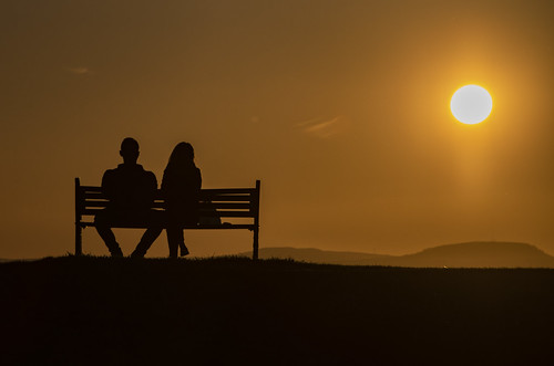 southwales tramsteer bristolchannel batterypoint hills breconbeacons silhouette sun bench people man woman sunset