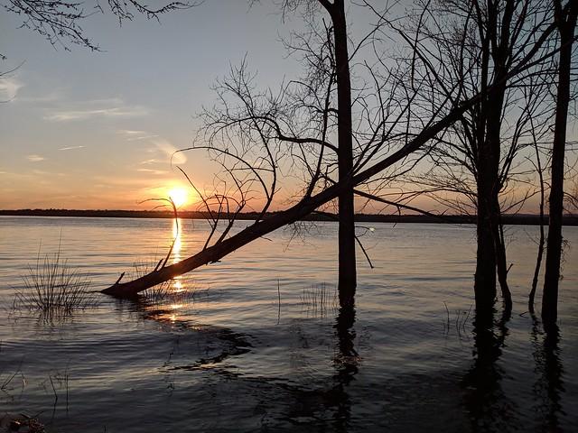sunset over flooded river