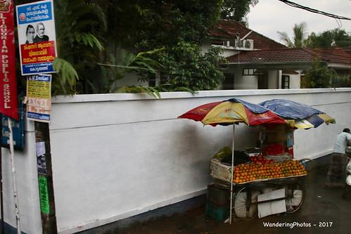 Umbrellas covering the orange stall - Cochin Kerala India