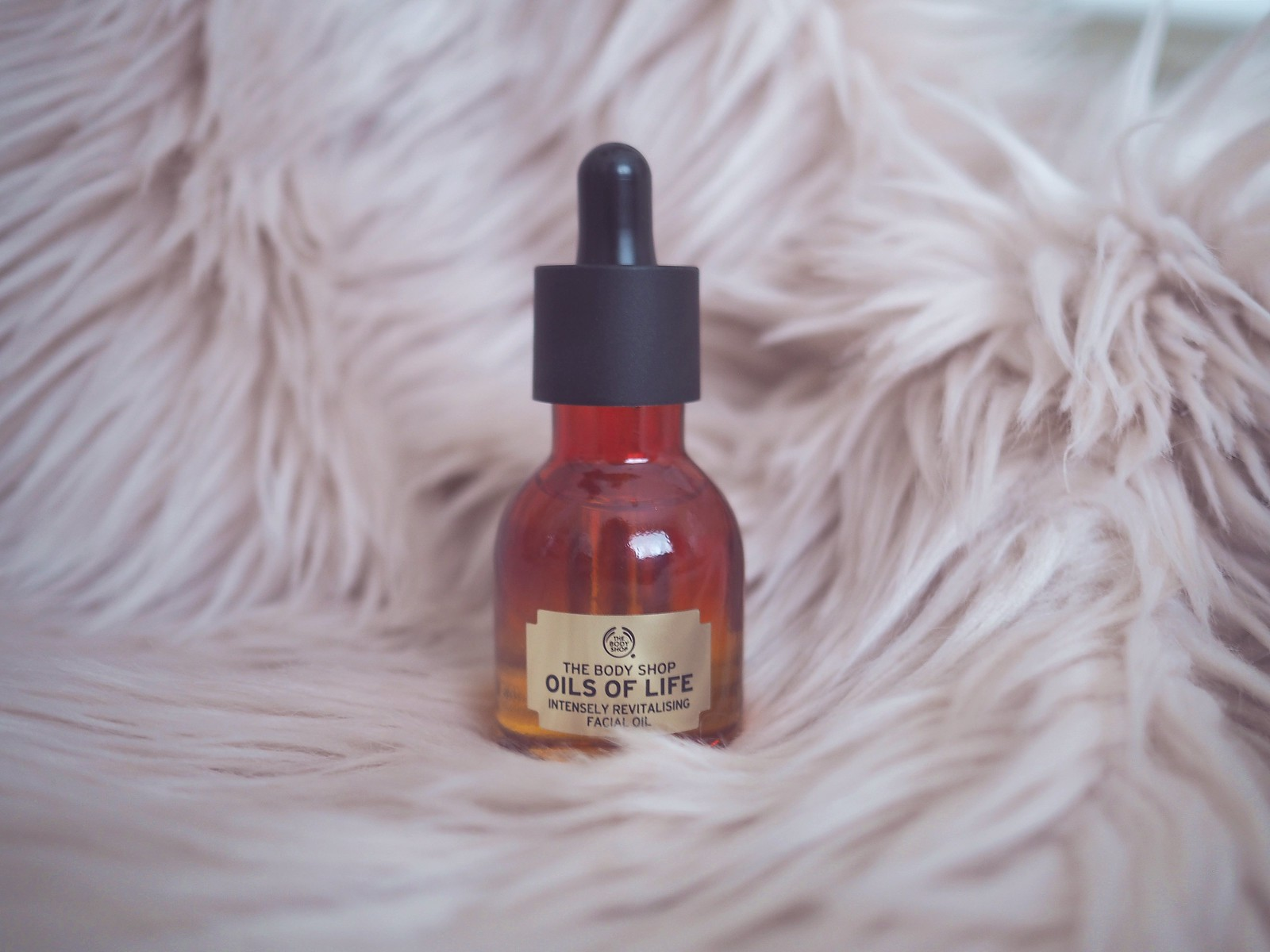 oils of life face oil the body shop