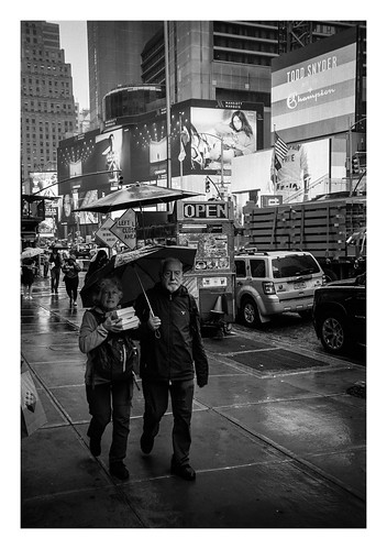 FILM - Carrying lunch through Times Square in the rain | by fishyfish_arcade