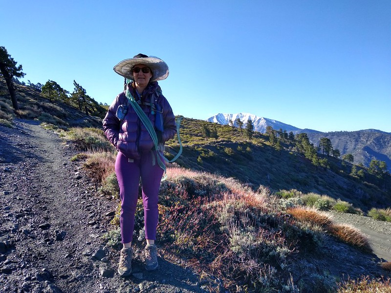 Vicki wearing her purple outfit (with goose down jacket) as we hike up Blue Ridge on the PCT