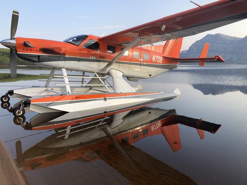plane sitting on lake