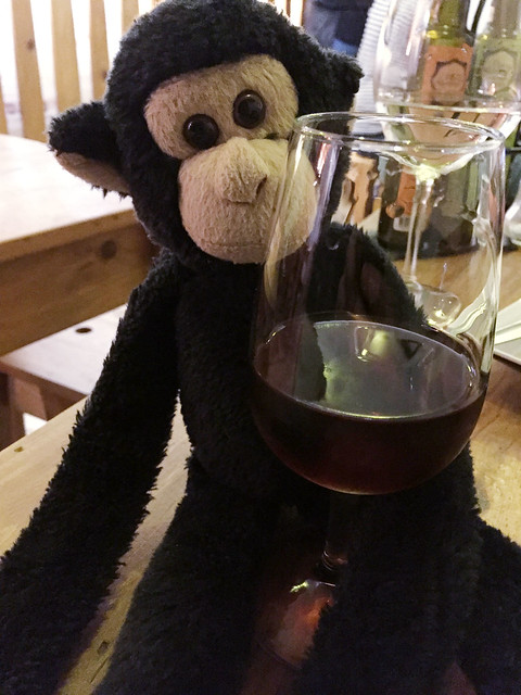 Monkey unwinding with a glass of port