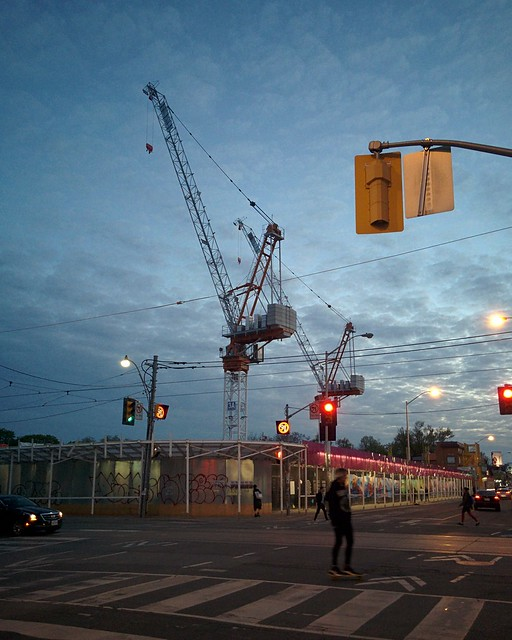 Crane against twilight sky over the Honest Ed's site #toronto #honesteds #bloorstreetwest #bathurststreet #demolition #construction #cranes #twilight #blue #latergram