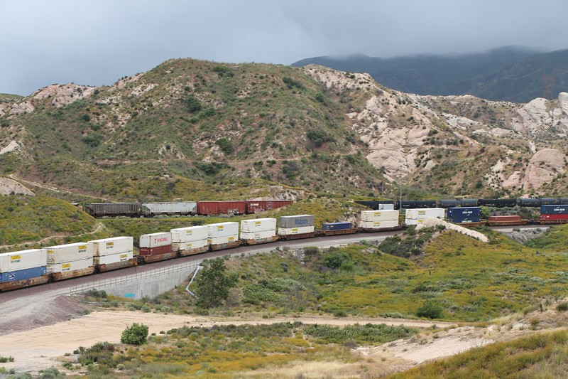 Zoomed-in view of two freight trains going opposite ways in Cajon Canyon
