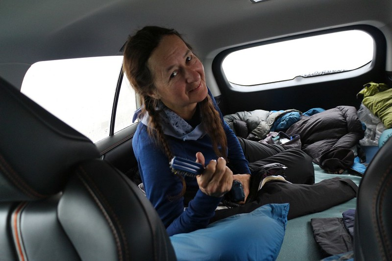 Vicki staying warm in the back of our new Rav4 while the wind howls outside - better than a tent