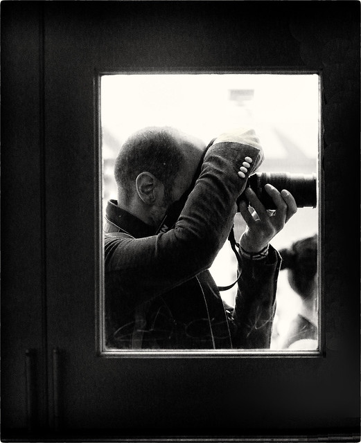 Street photographer Thru a Pub Window