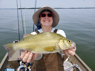 Christina Gebhard holds a whopper of a white perch that she caught