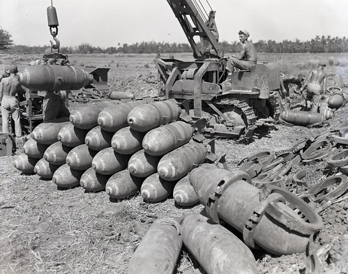 500-lb. general purpose bombs, their tails assembles, waiting to be transferred to trailers, and loaded on Douglas Dauntless dive bombers (SBDs) of the 1st MAW's Luzon-based squadrons. Location Luzon Philippines Unit March 1945.