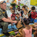 October 4, 2018 - 09:48 - Nucci with Kids – Photographer Unknown.    Photo shows St. Lucie Sheriff's K9 team Brandon Nuccio and K9 Dallas with a group of kindergarteners.