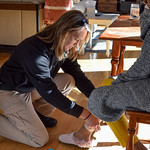 March 6, 2019 - 15:03 - Photographer: Alicia Stemper  Date taken: March 6, 2019  Brief Description: Corporal Peele changes the battery in a life track device. See further description below copied from our website.  Names of individuals in image: Corporal Ashley Peele  Orange County Sheriff's Office Hillsborough, Orange County, North Carolina  LIFE TRACK is a rapid response program that locates people with cognitive or mental health special needs who wander away from their caregivers. Clients may have Alzheimer's, Autism, Down Syndrome, Dementia or other cognitive or mental health special needs. Clients enrolled in the program are fitted with a bracelet or anklet that contains a battery operated transmitter and emits a tracking signal. If person wearing the bracelet wanders away, the caregiver calls 911. Members of our team immediately respond to the wanderer's area and use a mobile receiver to locate the person. On average, the wanderer is successfully located within thirty minutes.