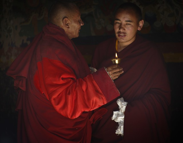 Monks in candle light, Tibet 2018
