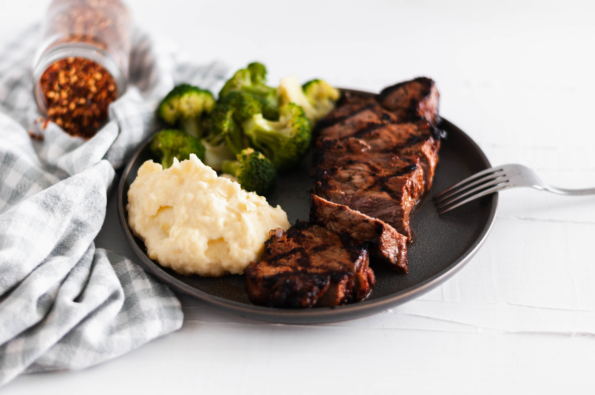 This simple Spicy Steak Marinade is packed with flavor and spice. Marinate some big steak and make dad's day this Father's Day.