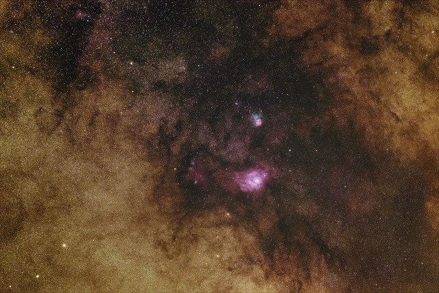 Lagoon and Trifid Nebulae in the Milky Way