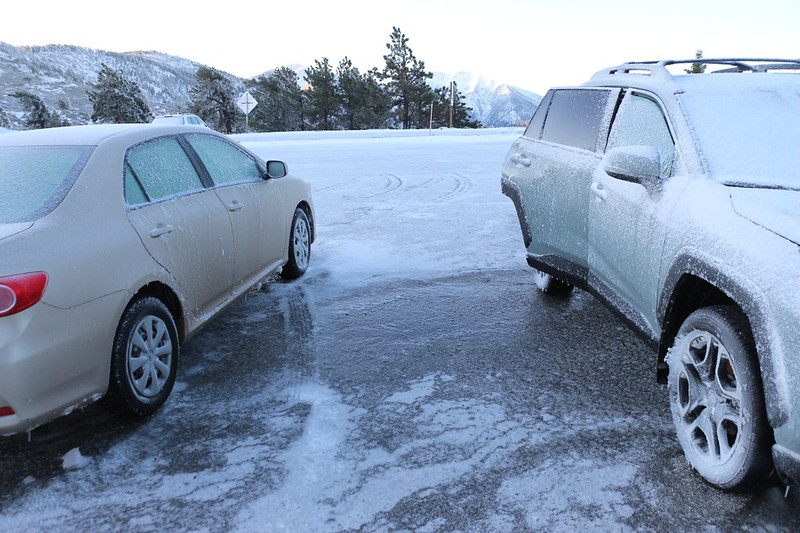 Slippery Ice between the two cars in the Inspiration Point parking lot at dawn