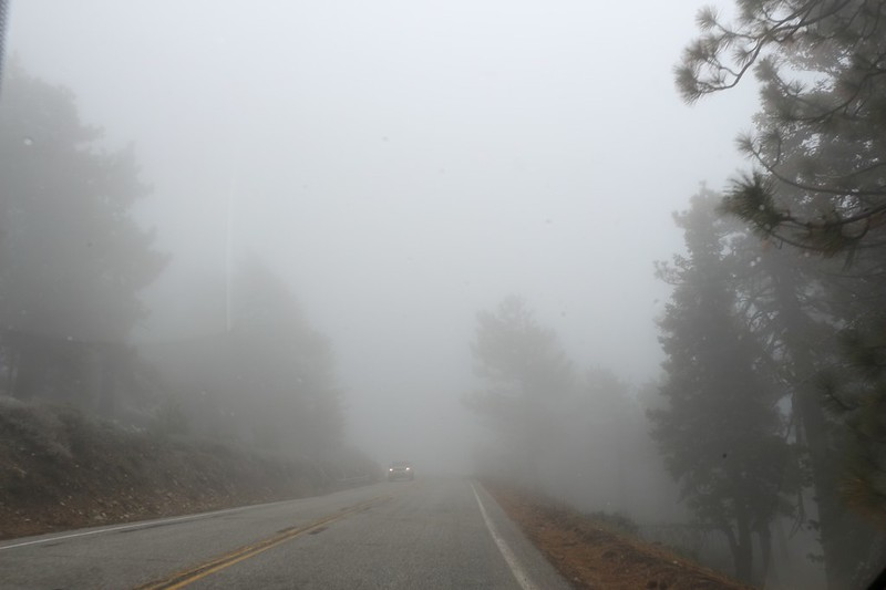 Heading back home on Angeles Crest Highway as clouds drift across the road