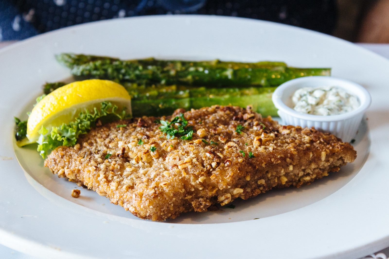Plate of pecan-crusted fish with asparagus