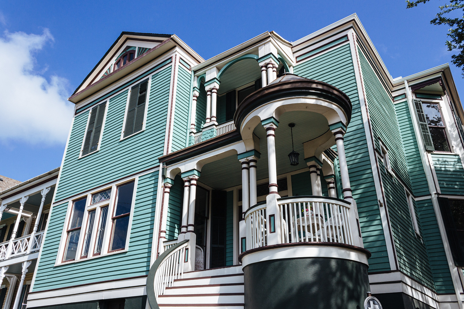 Two-story Victorian home with teal walls
