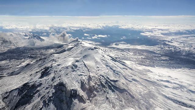 Above the smoking volcano