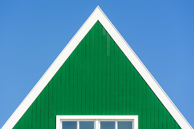 Green house with white edge
