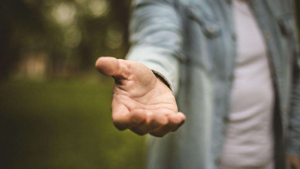 Man extending a hand.