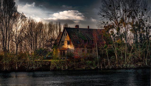 Sunset view of a home along the Seine River in Les Andelys, France 62a