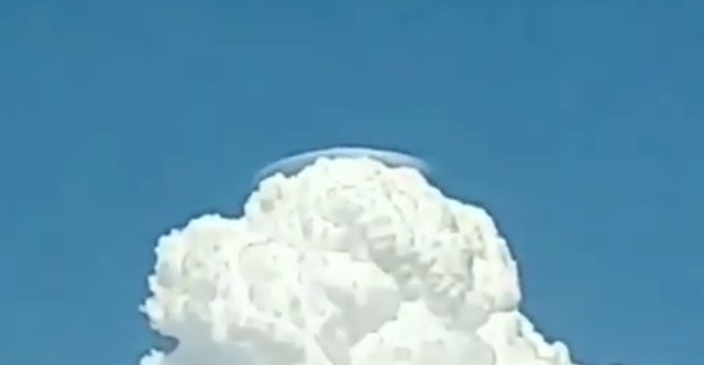 Silver Flying Saucer Hiding Behind The Clouds This Is real