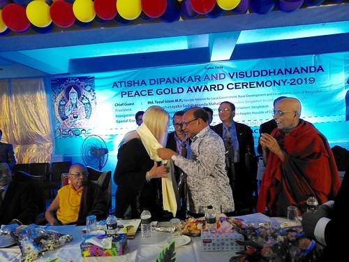 Minister Md. Tazul Islam M.P putting the shawl around Vassula's neck