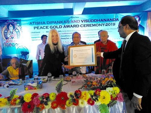 Receiving the Peace Gold Award plaque