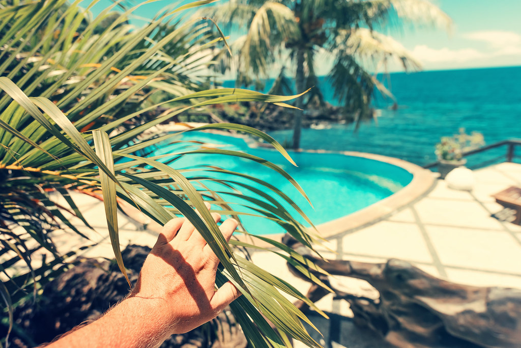 Man hand on the tropical swimming pool background | Man hand ...